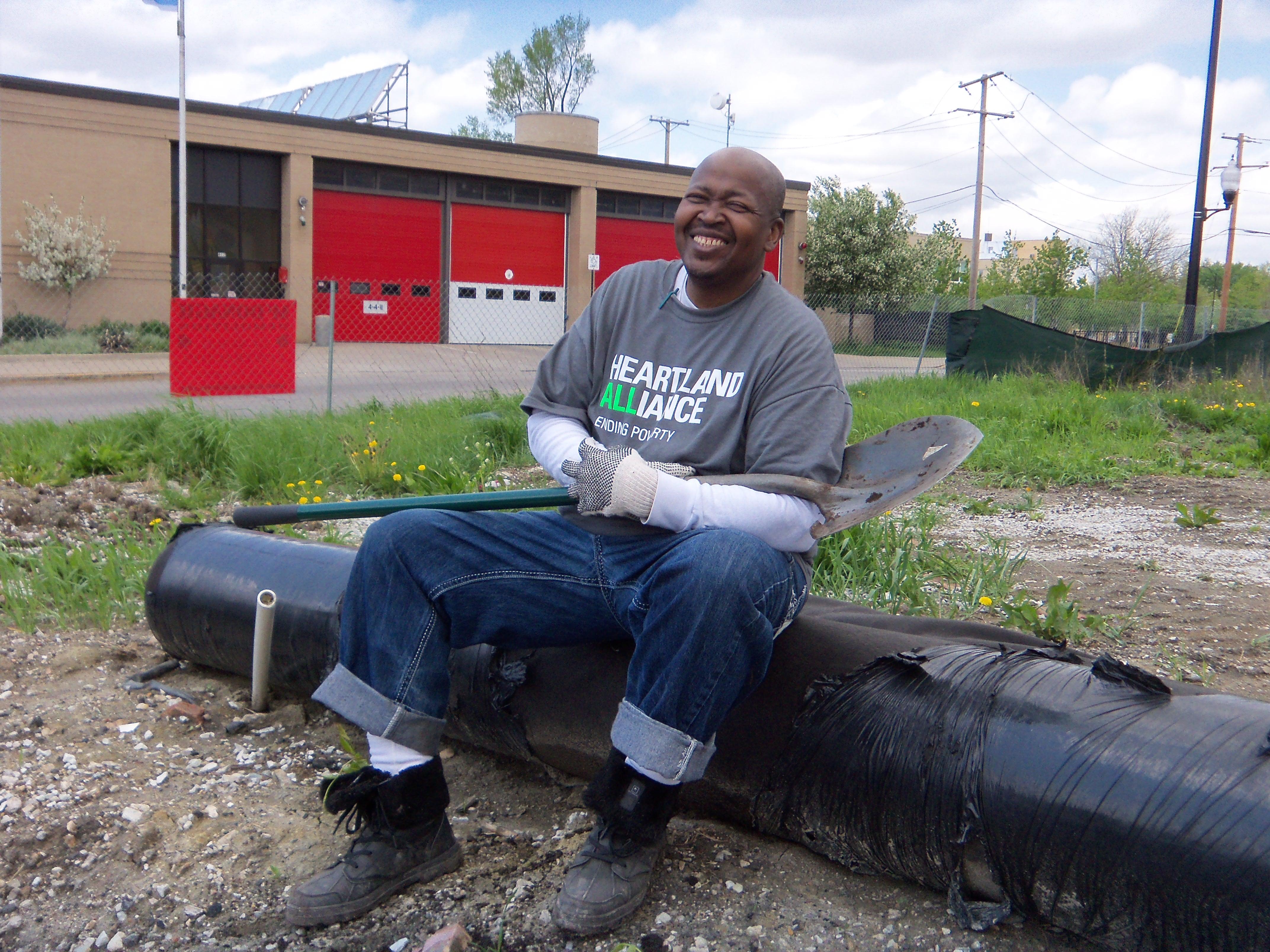 urban farm man with shovel